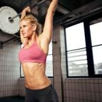 Woman getting lean with barbell shoulder press