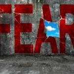 Fear of fitness expressed as fear in red letters on a wall being broken
