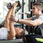 Online Training, trainer coaches dumbbell press