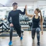 Top personal trainer high fives client